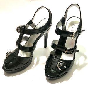 Guess black buckle heels size 7